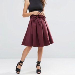 Burgundy satin box pleat skirt with bow